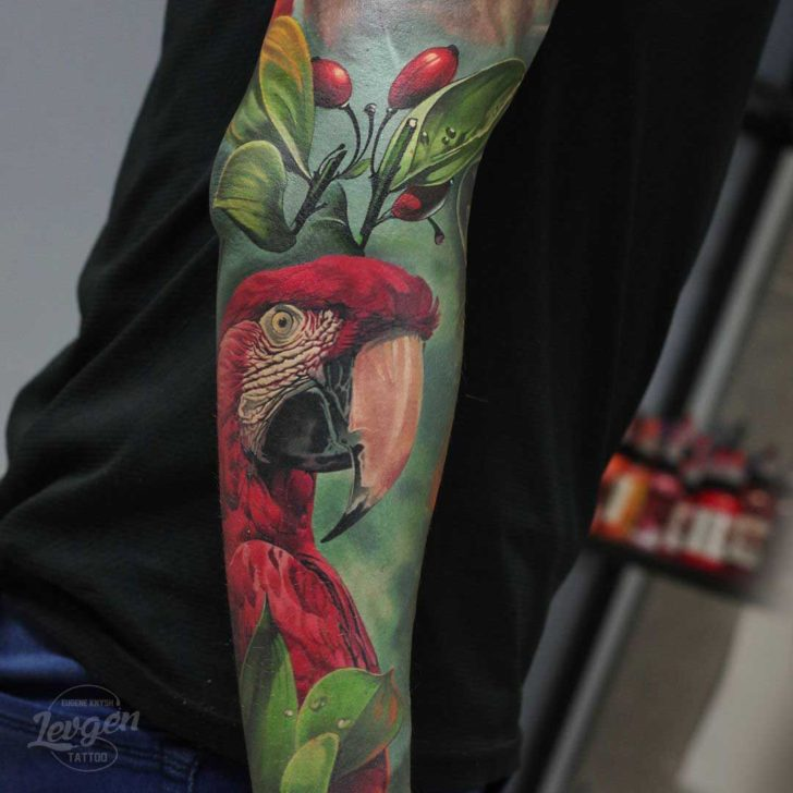realistic parrot tattoo on forearm