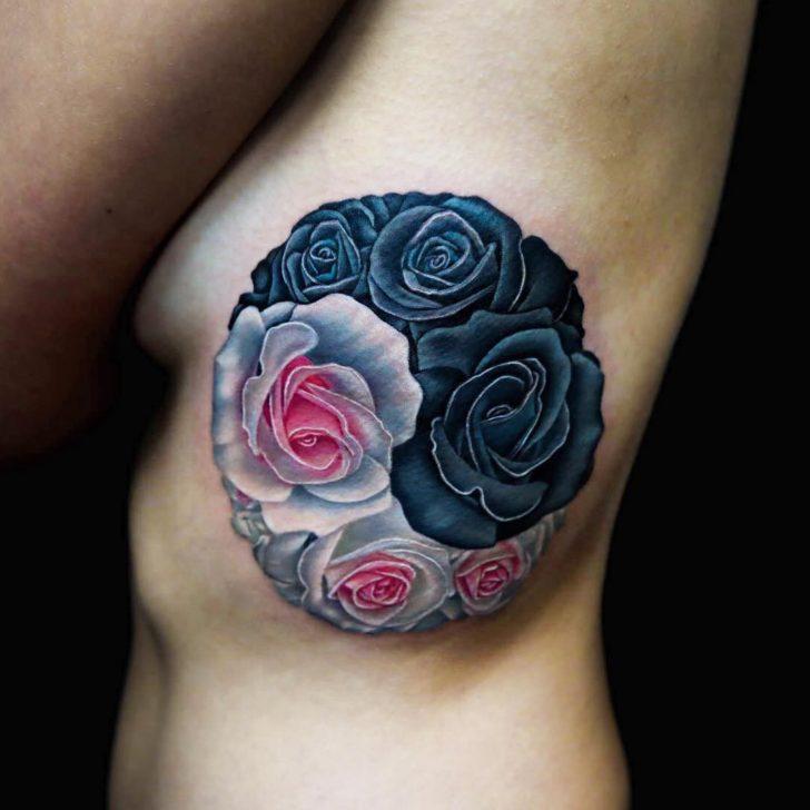 rib tattoo Yin Yang roses