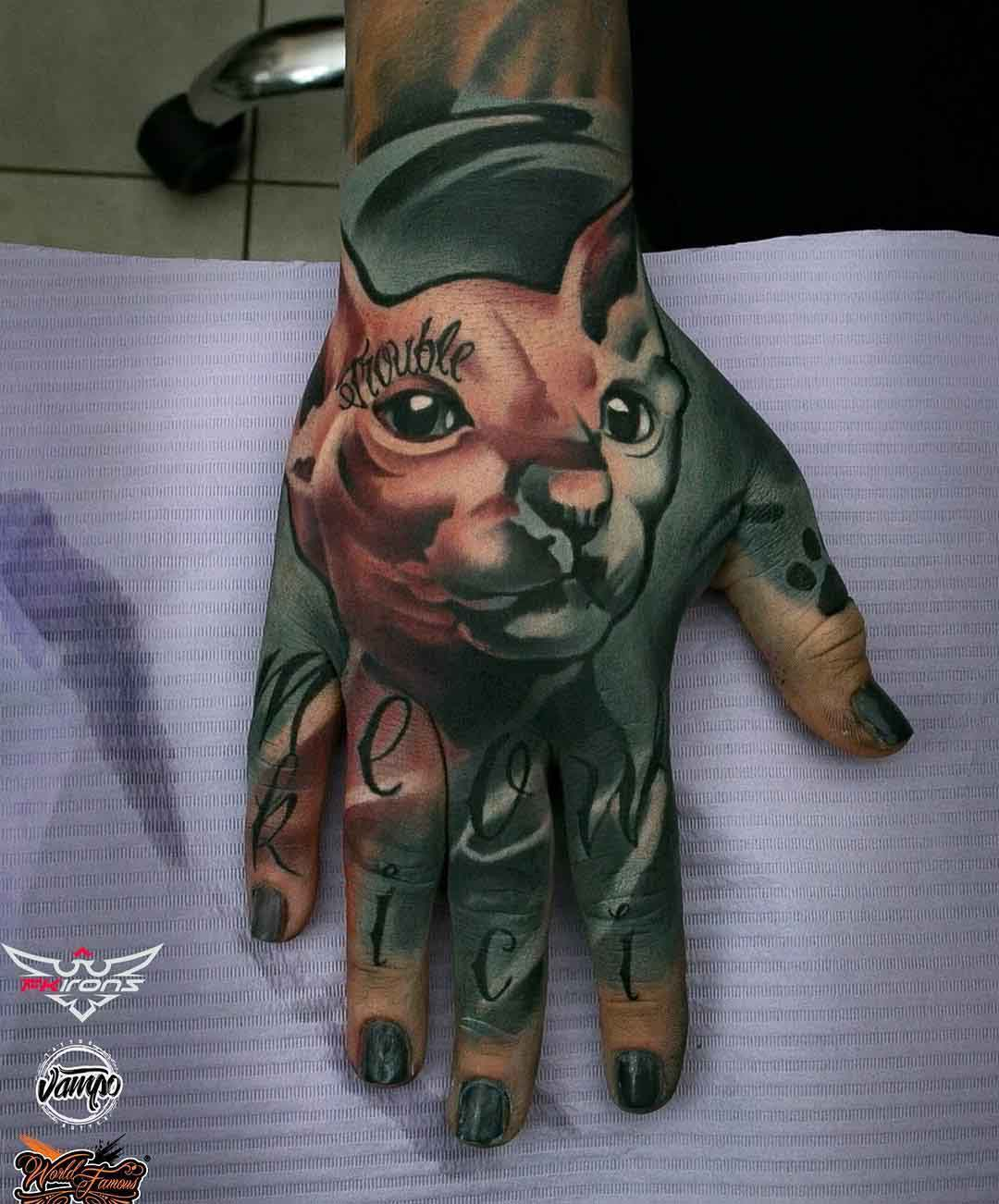 hand tattoo sphynx cat