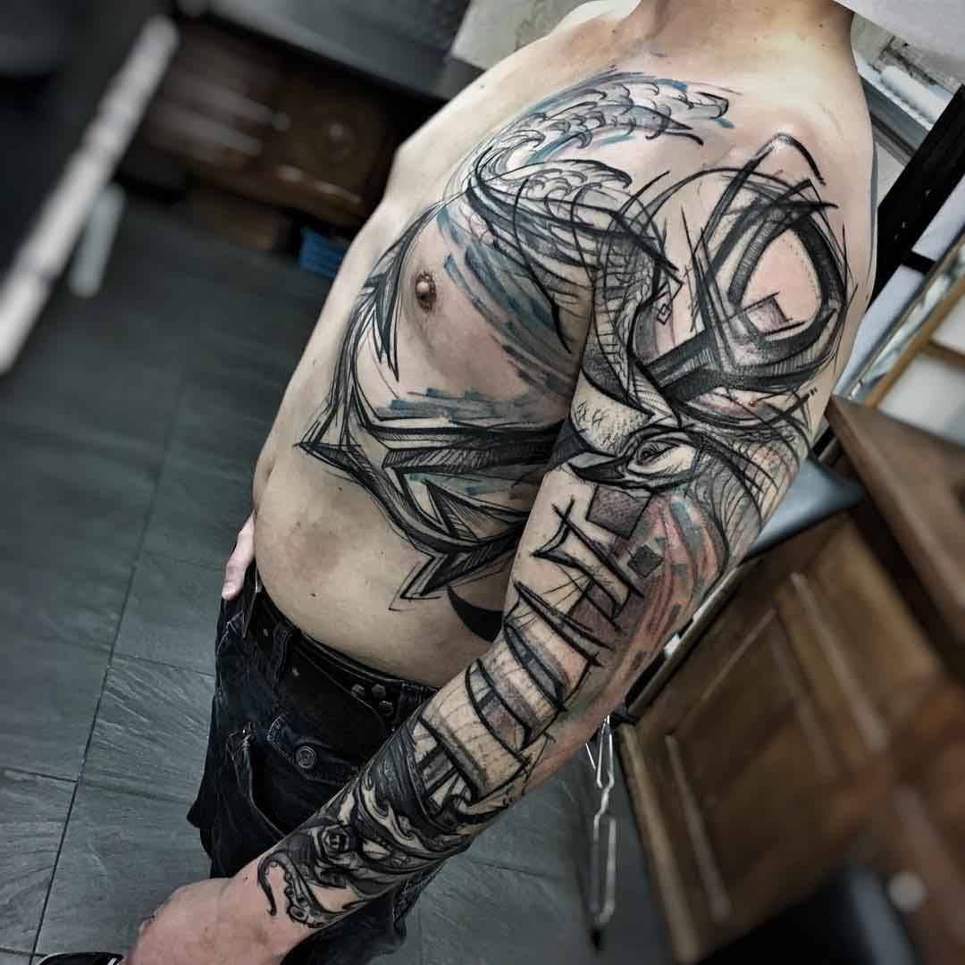 side torso and sleeve anchor tattoo