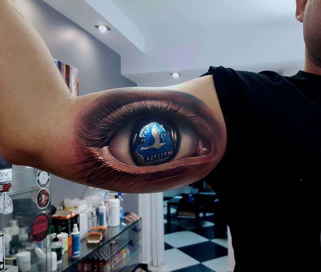 Stal Rzeszów football club tattoo eye on bicep