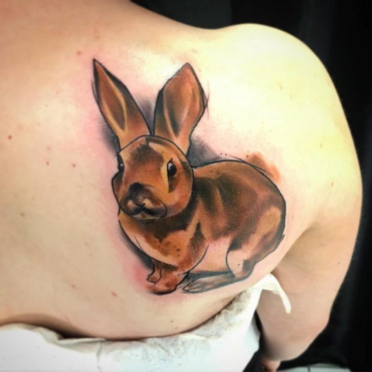 bunny tattoo on shoulder blade