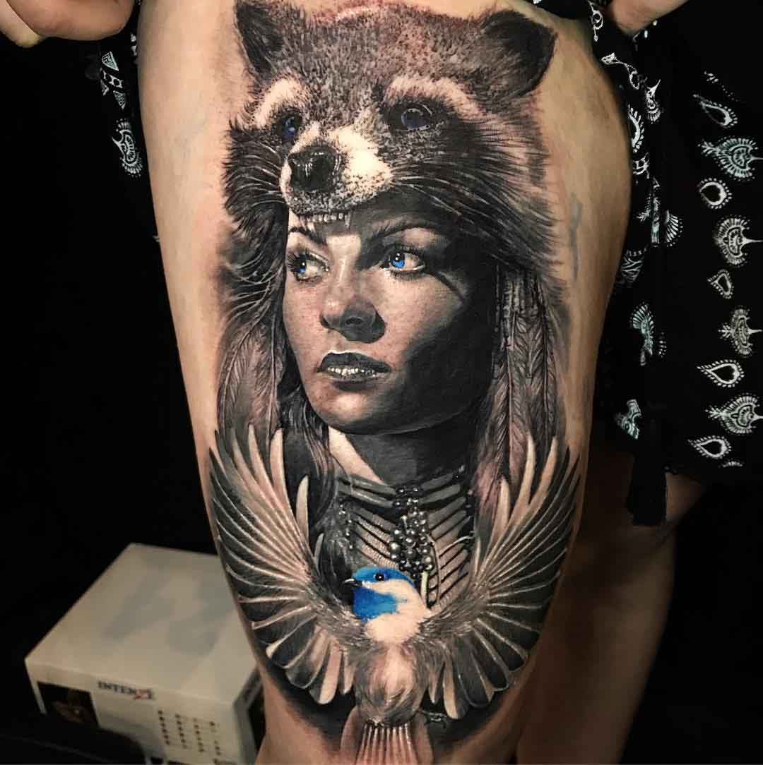 thigh tattoo portrait with coon hat