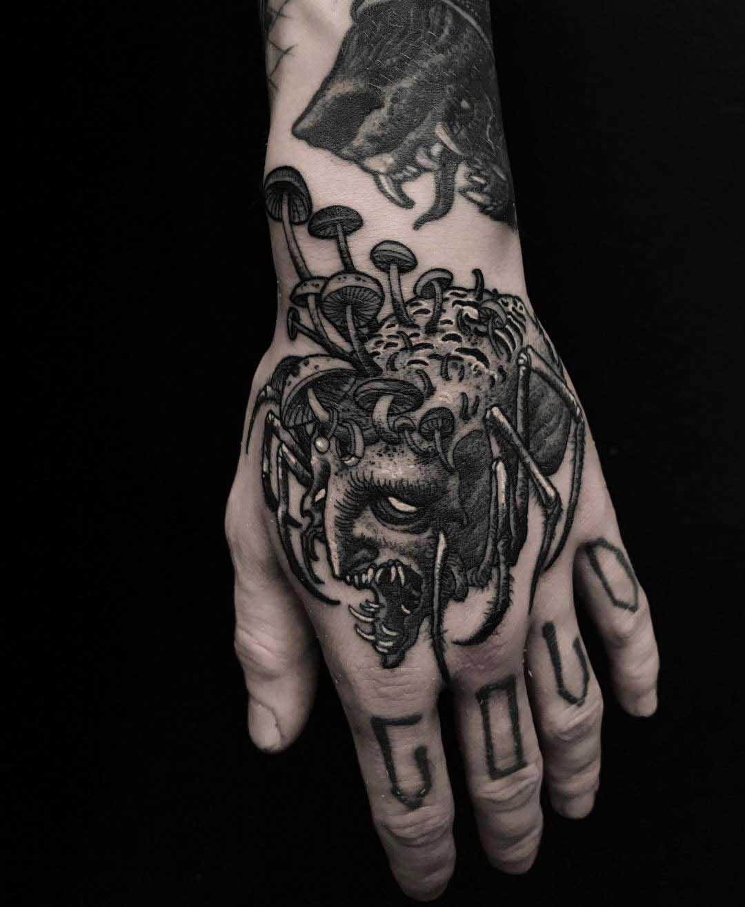 hand tattoo spider monster