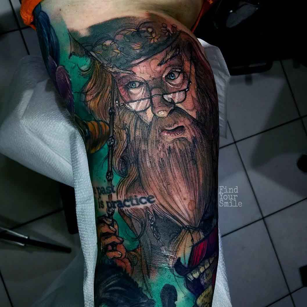 tattoo of a dumbledore on bicep