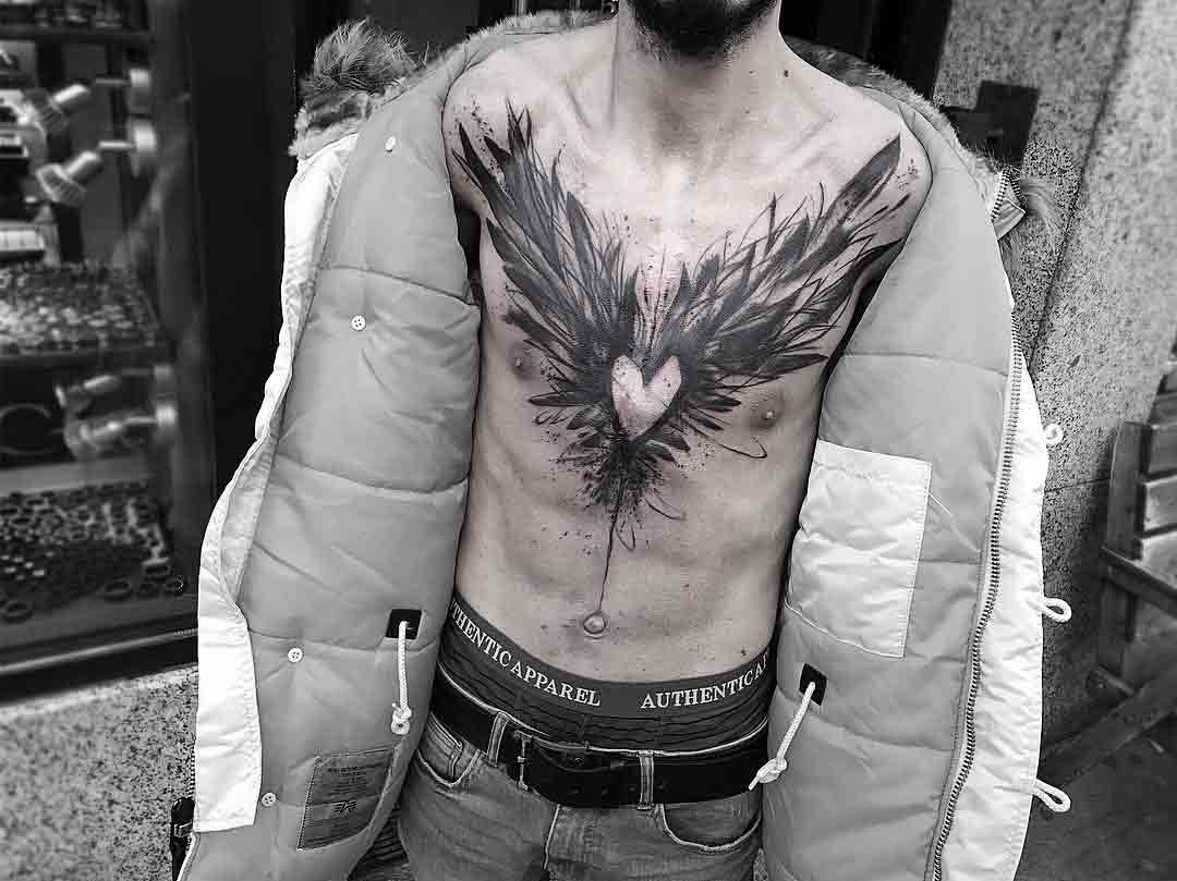 chest tattoo heart with wings