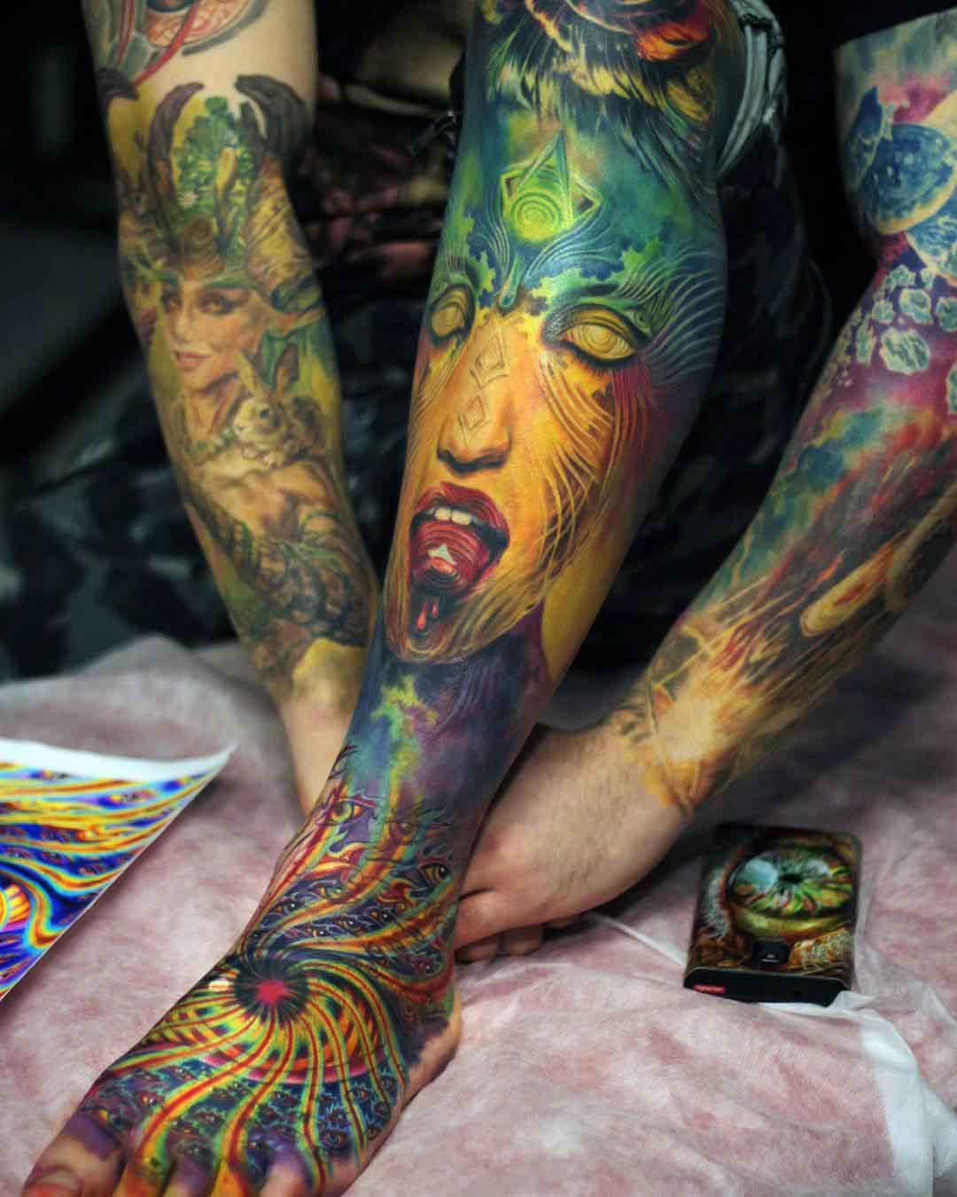 spiritual sleeve tattoo on leg