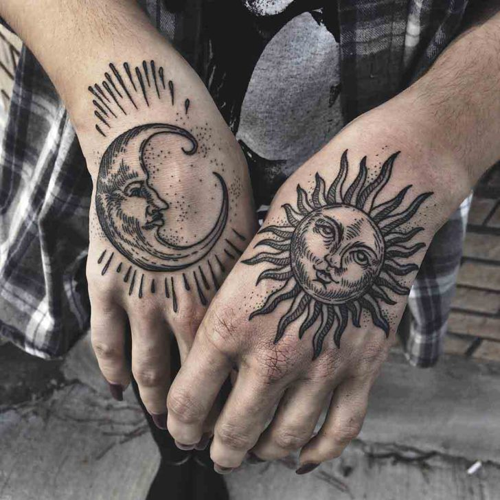 hand tattoos of moon and sun