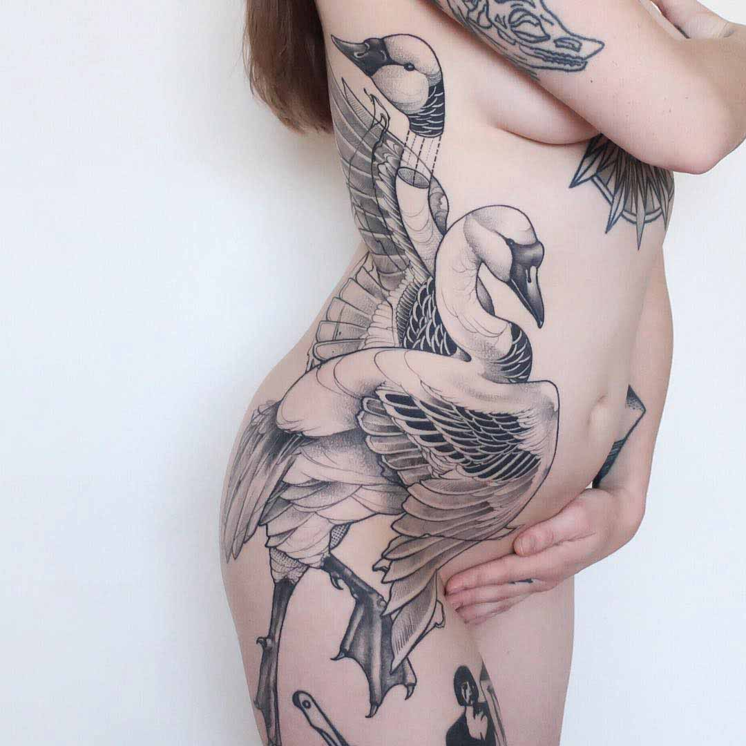 body side tattoo swans