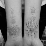 White Tattoos on Wrists