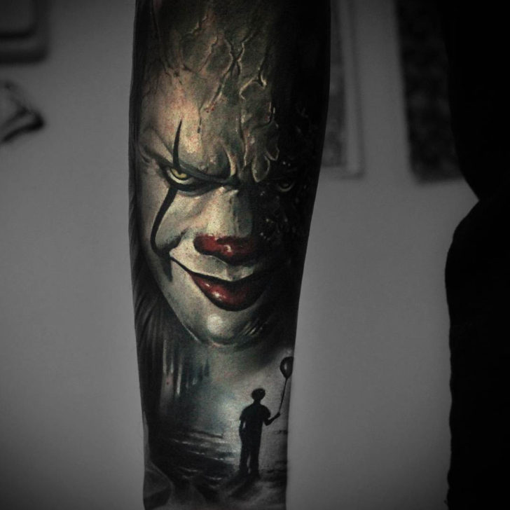 horror clown tattoo on arm Pennywise
