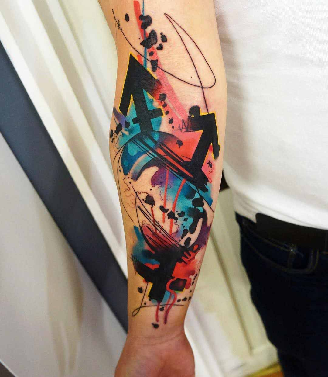 watercolor arrows tattoo on arm