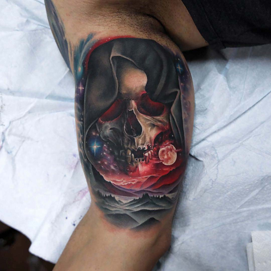 bicep tattoo skull death