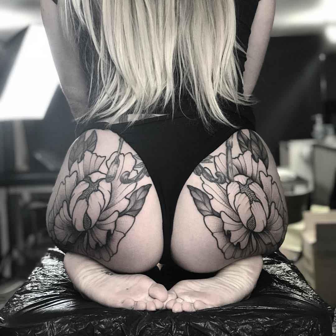 girl flowers tattoos on hips