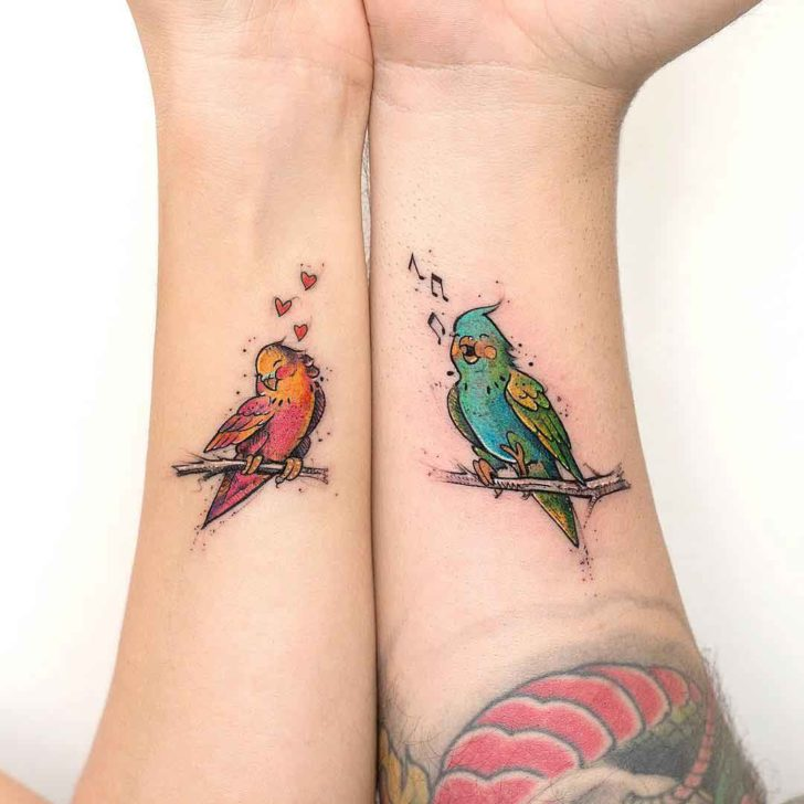 arm tattoo birs for couple