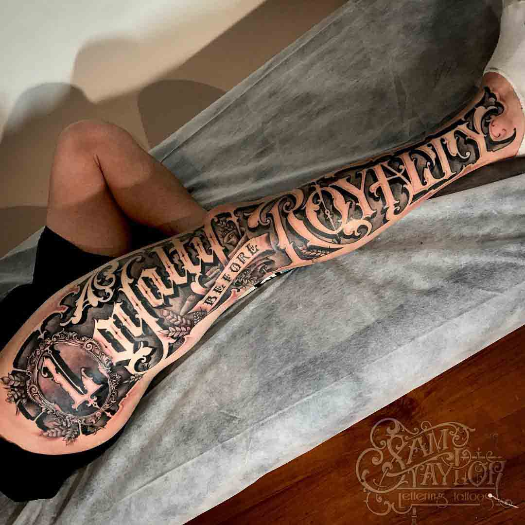 leg tattoo lettering chicano