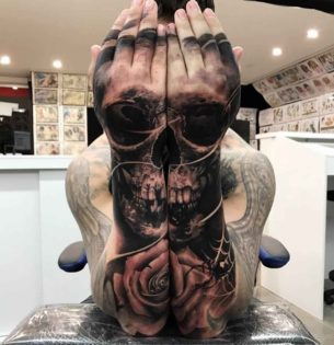 Matching Skull Tattoos on Both Arms