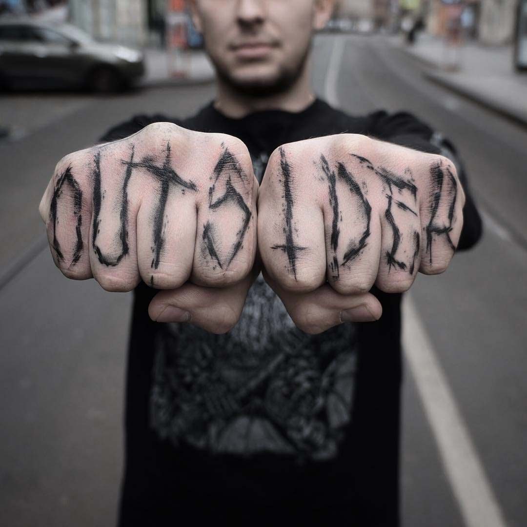 finger tattoo outsider lettering