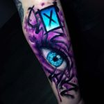 Purple Eye Tattoo on Arm