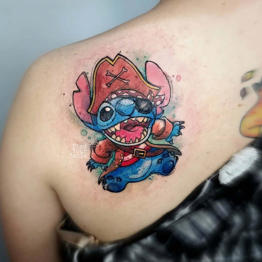 watercolor stitch tattoo on shoulder blade