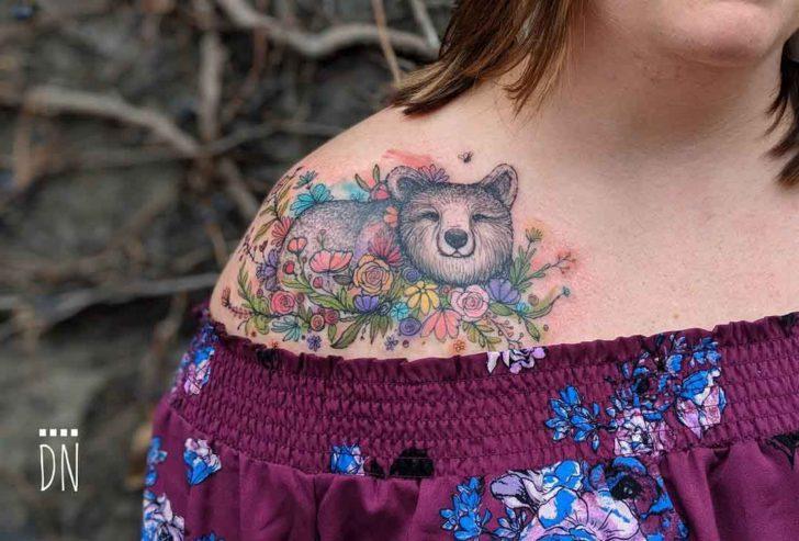 collar bone tattoo bear with flowers