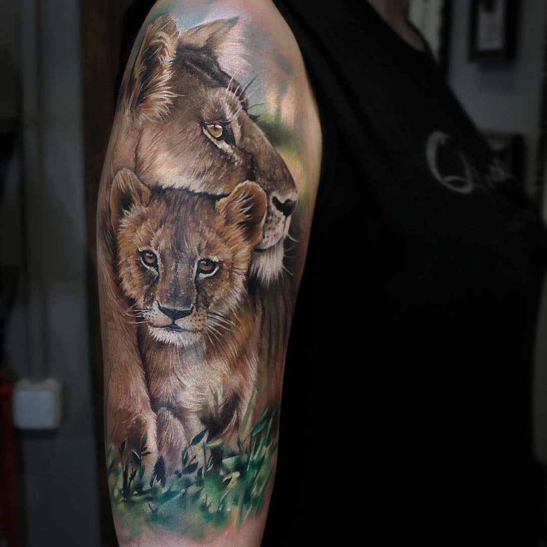 lion tattoo with cub