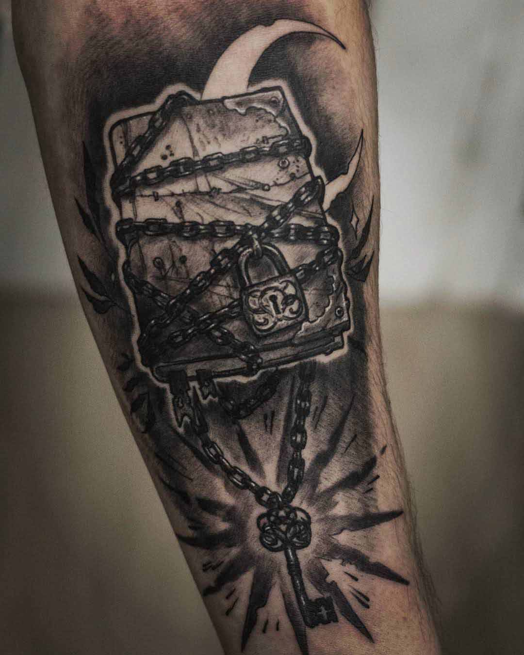 chained book tattoo of magic