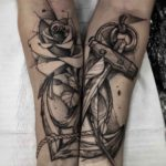 Matching Anchor Tattoo on Forearms