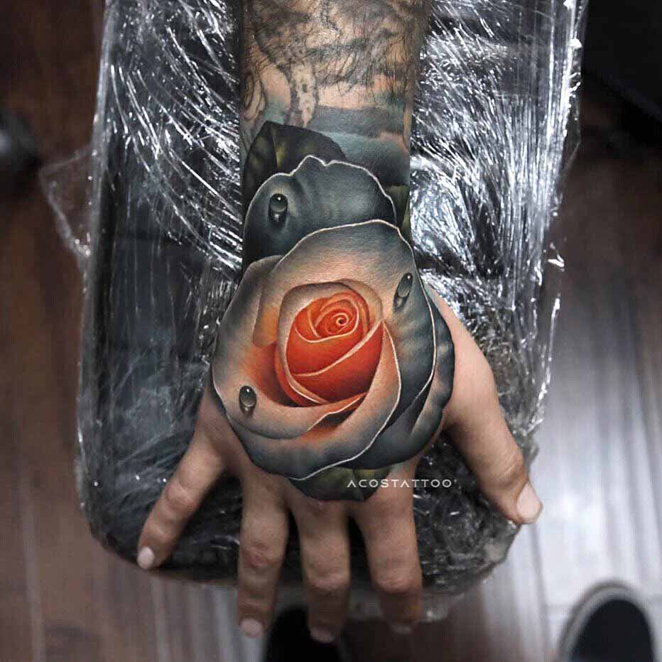 grey soft rose tattoo on hand