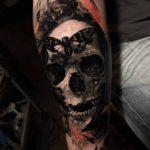 Grey Skull Butterfly Tattoo