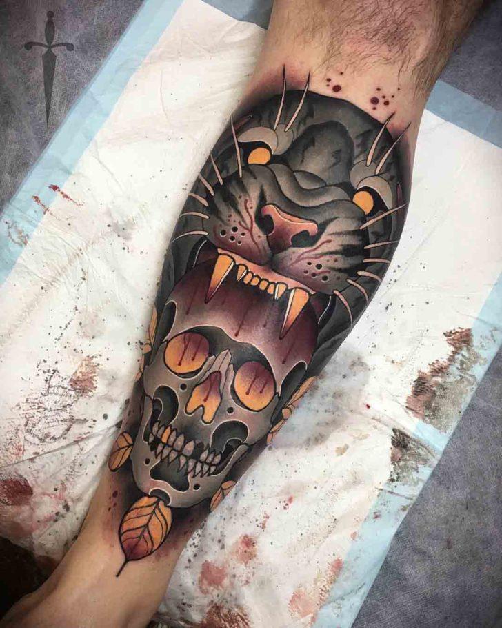 calf tattoo skull and tiger