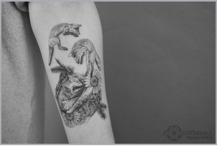 arm tattoo three foxes