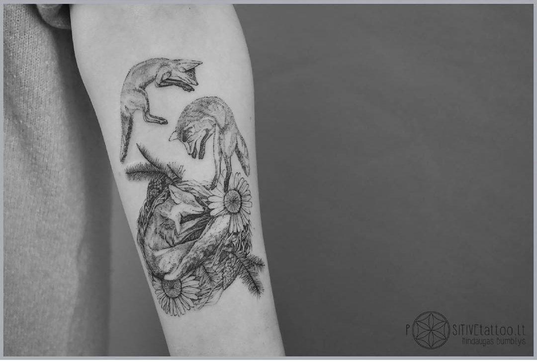 arm tattoo three foxes