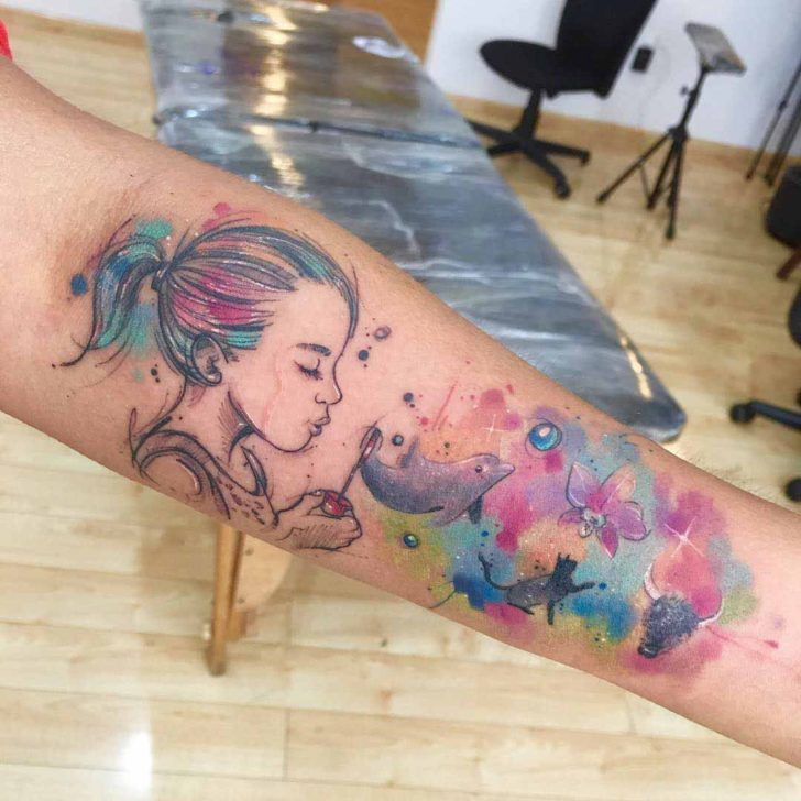 imagination tattoo on arm watercolor style