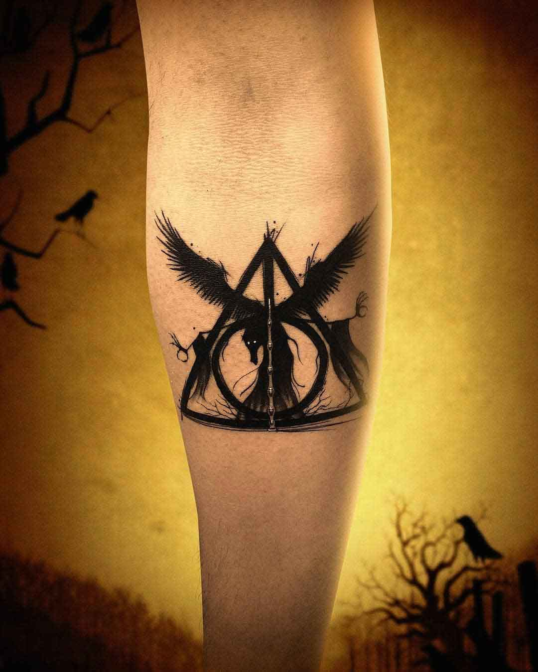 deathly hallows tattoo on arm