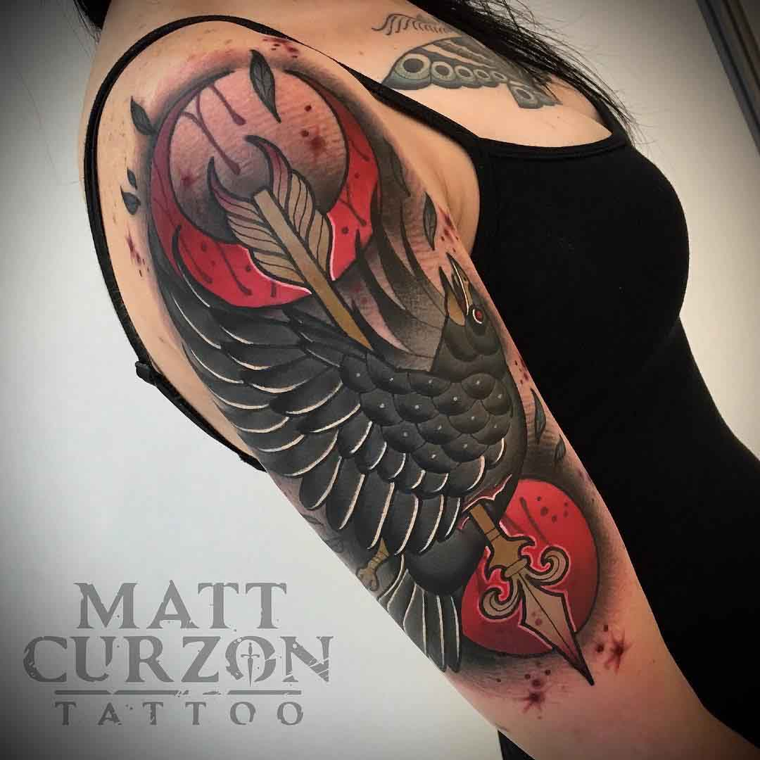 neo-traditional shoulder tattoo crow with arrow