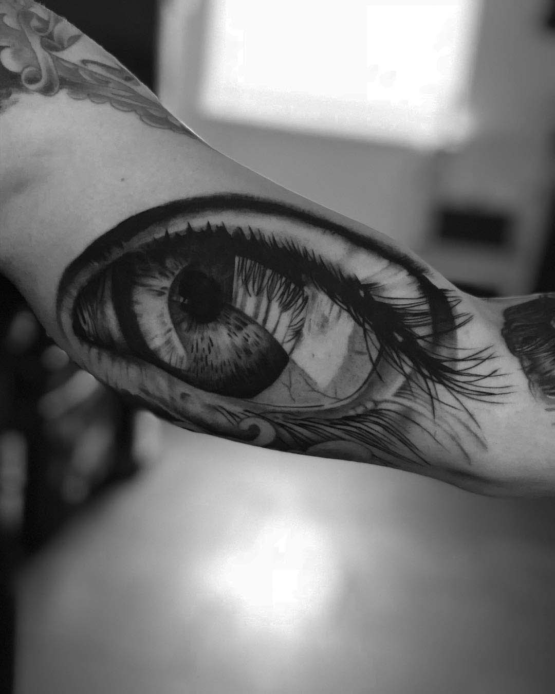 bicep tattoo black and grey eye