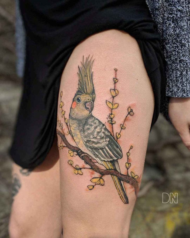 parrot tattoo on thigh