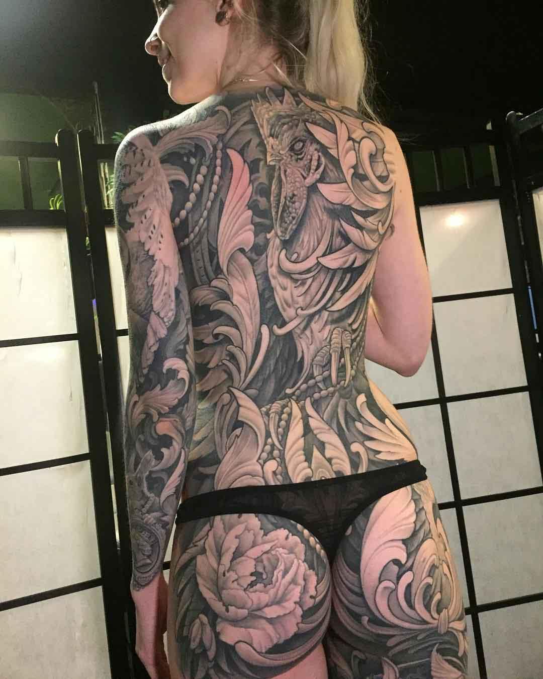 girl full back tattoo