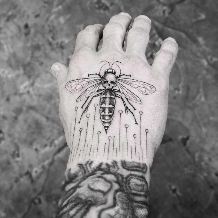hand tattoo wasp with skull