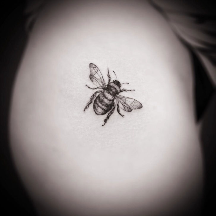 tiny tattoo of a bee