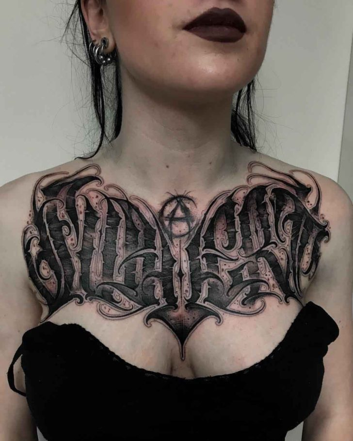 gothic lettering tattoo on chest