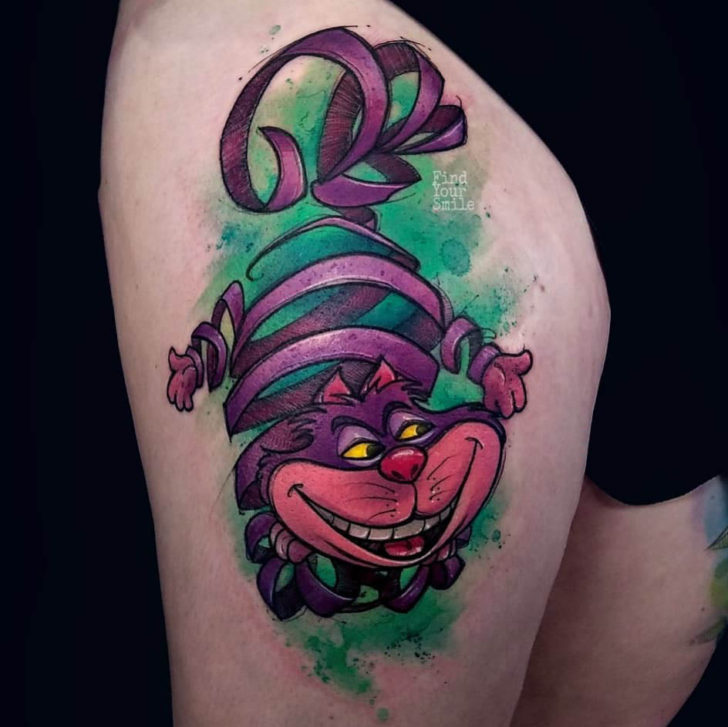 cool cheshire cat tattoo on thigh