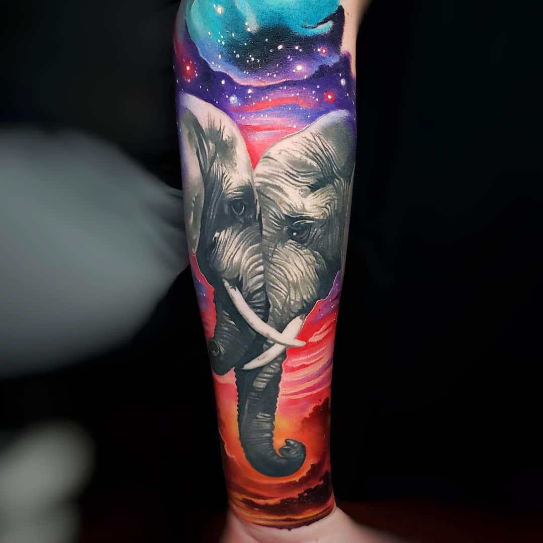 two elephants tattoo on arm