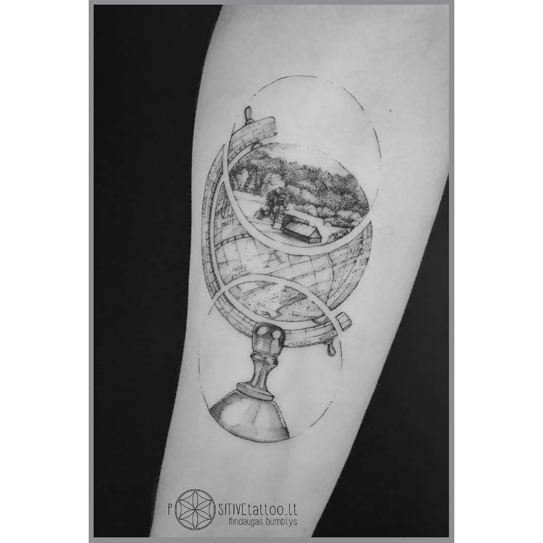 globe tattoo on arm lithuanian landscape