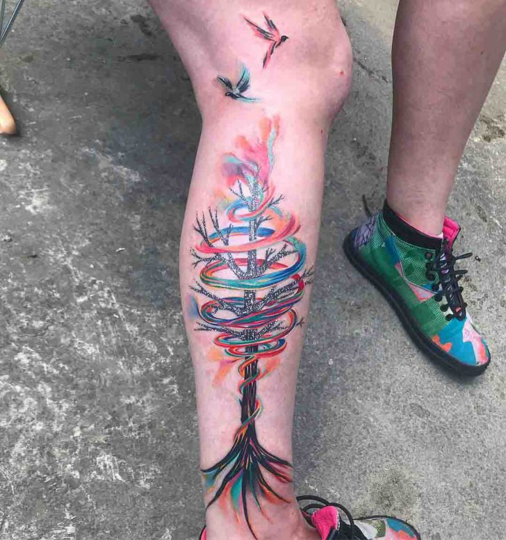 tree tattoo on calf made of rainbow