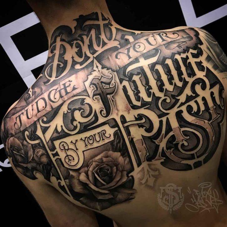 Blowball Text Tattoo: Upper Back Tattoo Lettering