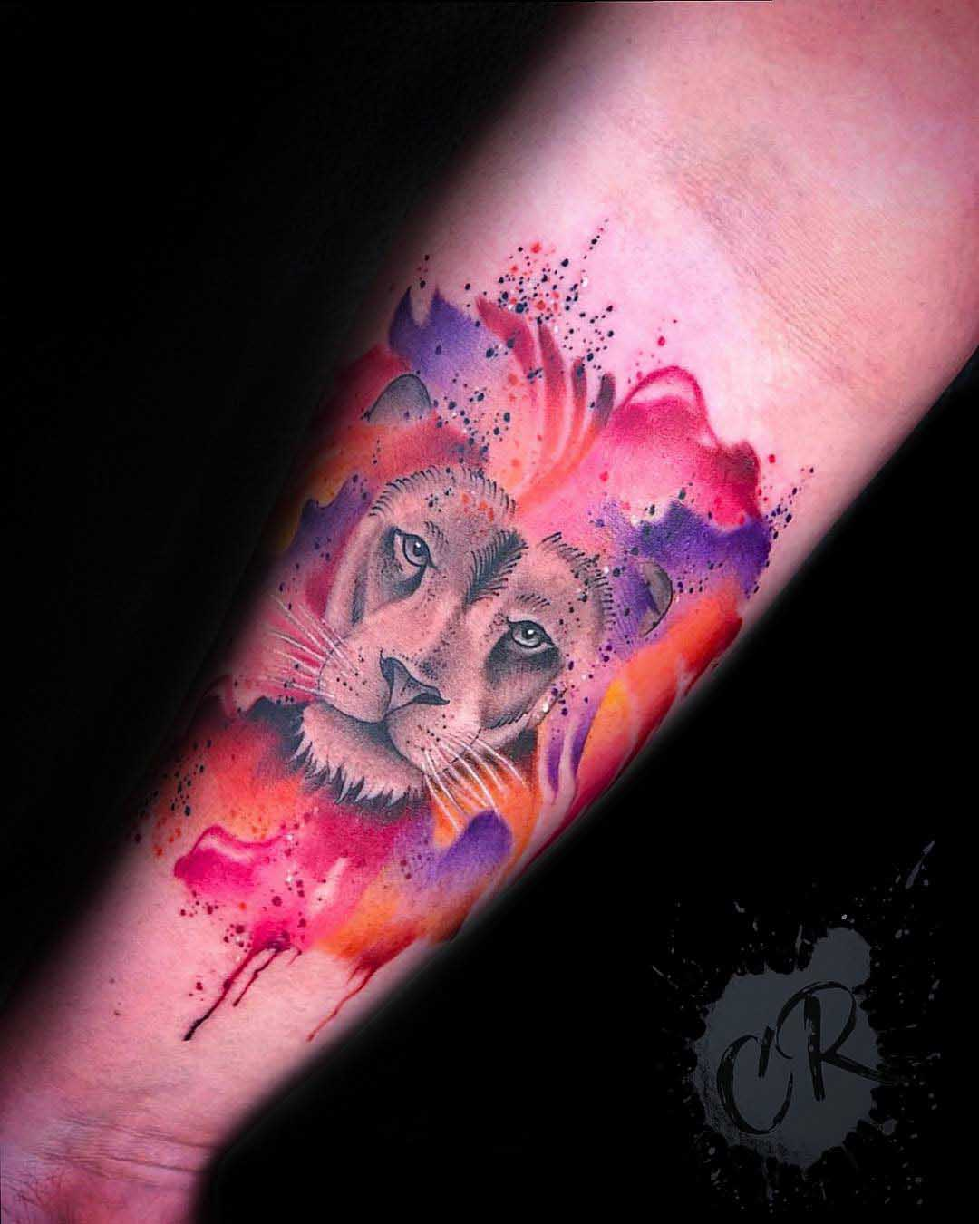 arm tattoo lion watercolor style
