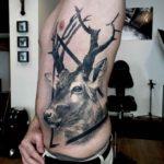 Deer Tattoo on Side by Roberto da Silva