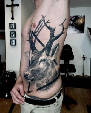 Deer Tattoo on Side by Roberto da Silva
